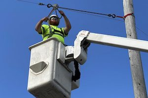 man fixing electric wire